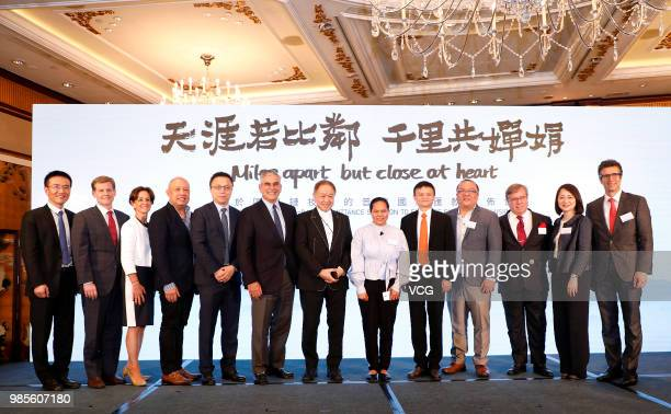 Alibaba Group cofounder and executive chairman Jack Ma and Canning Fok comanaging director of CK Hutchison Holdings Ltd pose during a news conference...