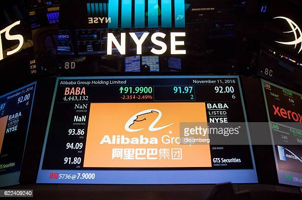Alibaba Group Holding Ltd signage is displayed on the floor of the New York Stock Exchange in New York US on Friday Nov 11 2016 US stocks fluctuated...