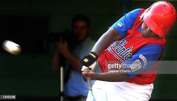 Alibay Barkley of the Harlem New York team connects for a solo home run in the fourth inning of the Little League World Series August 20 2002 in...