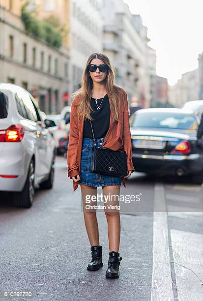 Alica Perrella wearing a Chanel bag denim skirt and boots during Milan Fashion Week Spring/Summer 2017 on September 24 2016 in Milan Italy