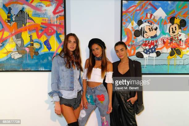 Alice Amelia JeffreyAna Tanaka and Amy Jackson attend Robyn Ward's opening exhibition of A Simpler Time on May 16 2017 in London England