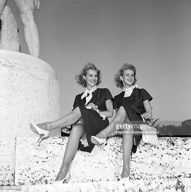 Alice and Ellen Kessler twin sisters and German artistic duo seated with crossed legs at the Foro Italico Launched by the Italian television the...