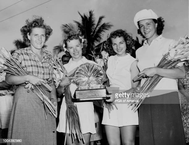 Alice and Marlene Bauer win fourball tournament in hollywood fl at the orange brook golf club courses in 1950 and stand with runnerups Betty Bush and...