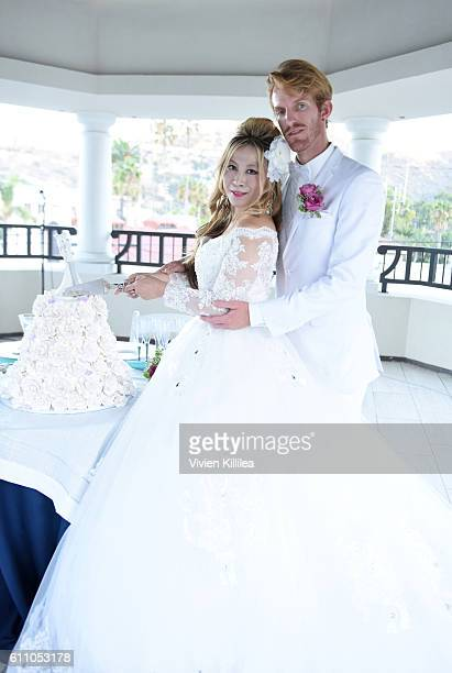 Alice Aoki and Justin Moore Aoki cut their wedding cake at their dessert reception at the Catalina Island Museum on September 25 2016 on Catalina...