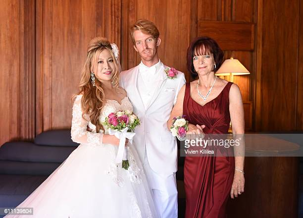 Alice Aoki Justin Moore and Karen Moore at the Aoki wedding ceremony at the Avalon Theater on September 25 2016 on Catalina Island California