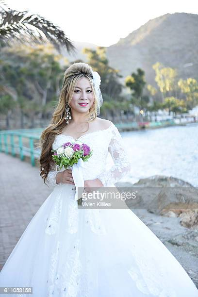 Alice Aoki poses for a portrait after her wedding ceremony at the Avalon Theater on September 25 2016 in Catalina Island California