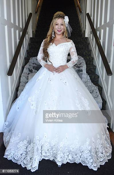 Alice Aoki wears a dress by Mikael D for her wedding ceremony on September 25 2016 on Catalina Island California