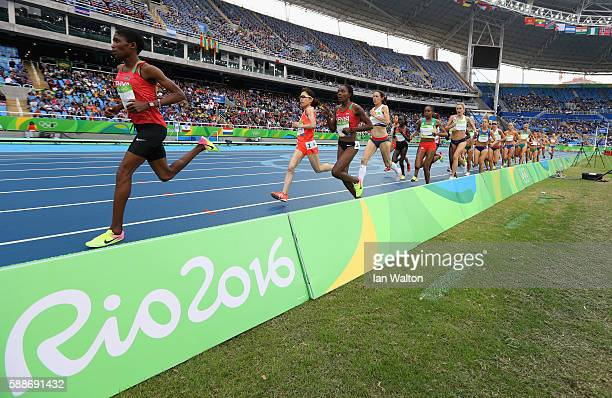 Alice Aprot Nawowuna of Kenya leads a group in the Women's 10000 metres final on Day 7 of the Rio 2016 Olympic Games at the Olympic Stadium on August...