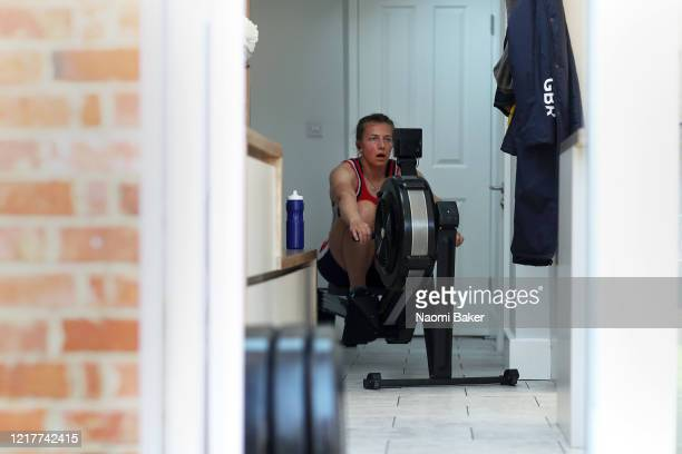 Alice Baatz of Great Britain trains on the ergo 'rowing machine' inside her kitchen on March 27 2020 in HenleyonThames England The coronavirus and...