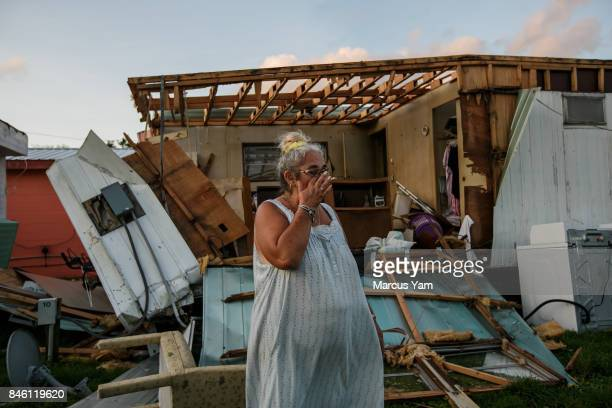 Alice Barber walks through her damaged trailer home in the aftermath of Hurricane Irma in Immokalee Fla on Sept 11 2017