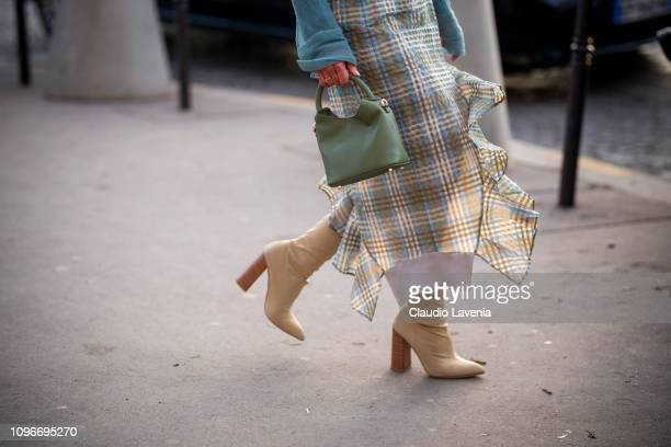 Alice Barbier bag details is seen in the streets of Paris before the Sacai show on January 19 2019 in Paris France