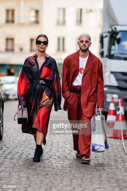 Alice Barbier from the blog 'J'aime tout chez toi' wears sunglasses a red and purple dress a studded bag black and yelow shoes Jean Sebastien Rocques...