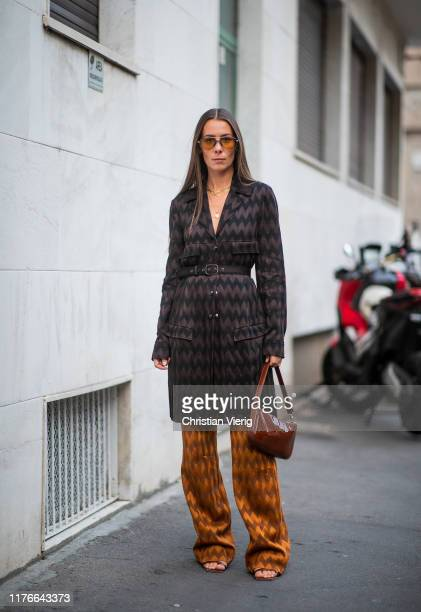 Alice Barbier is seen wearing belted coat with print and pants outside the Missoni show during Milan Fashion Week Spring/Summer 2020 on September 21,...