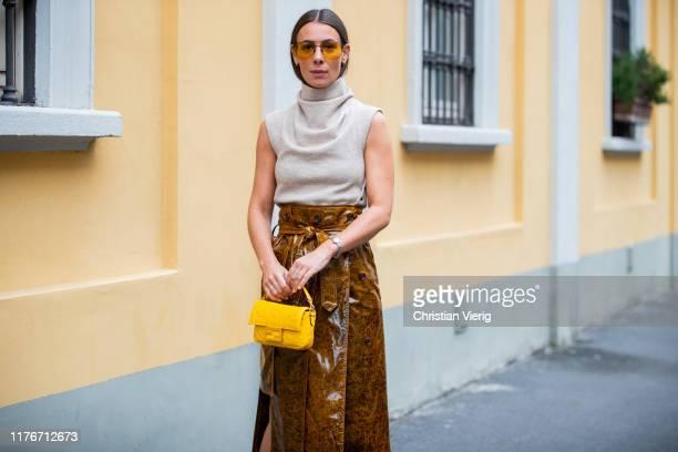 Alice Barbier seen wearing asymmetric skirt sleeveless knit yellow Fendi bag outside Boss during Milan Fashion Week Spring/Summer 2020 on September...