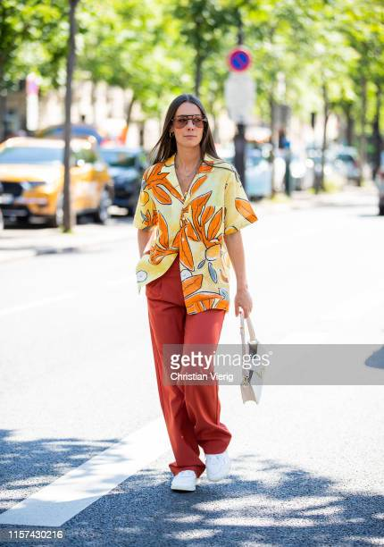 Alice Barbier seen wearing button shirt with floral print red pants outside Ann Demeulemeester during Paris Fashion Week Menswear Spring/Summer 2020...