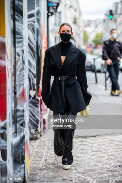 Alice Barbier wearing black blazer, bag, vinyl pants, face mask seen outside GAUCHERE during Paris Fashion Week - Womenswear Spring Summer 2021 : Day...