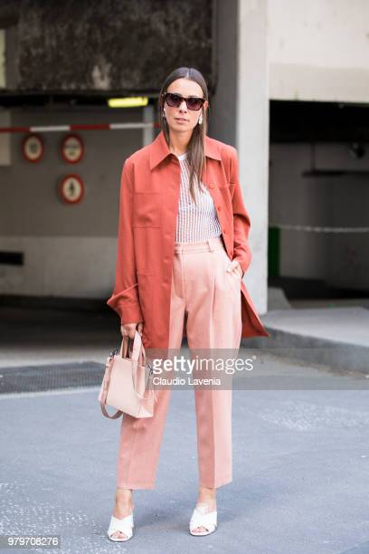 Alice Barbier wearing striped t shirt pink pants and brown trench jacket is seen in the streets of Paris before the Acne Studio show during Paris...