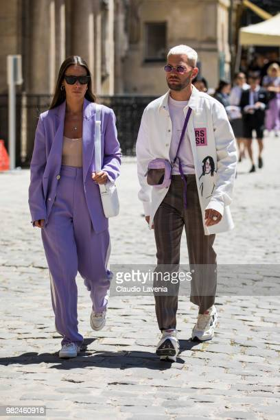 Alice Barbier wearing violet jacket and pants and Js Roques wearing white jacket and checked pants are seen in the streets of Paris before the Thom...