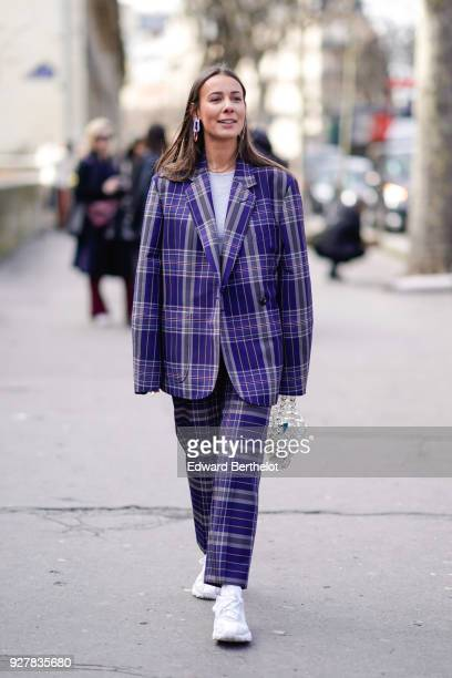 Alice Barbier wears a blue checked pattern oversize suit and blazer jacket white sneakers shoes outside Giambattista Valli during Paris Fashion Week...
