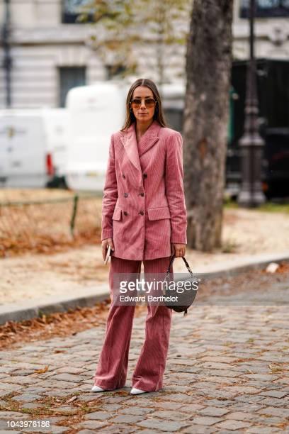 Alice Barbier wears a pink blazer jacket pink flare pants outside Akris during Paris Fashion Week Womenswear Spring/Summer 2019 on September 30 2018...