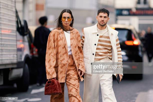 Alice Barbier wears sunglasses a white tshirt a brown pattern salmoncolored suit with elastic waist pants a rustcolored handbag JeanSebastien Rocques...