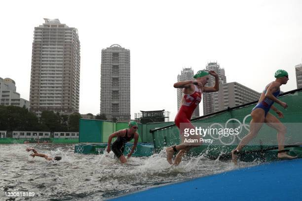 Alice Betto of Team Italy and Joanna Brown of Team Canada compete during the Women's Individual Triathlon on day four of the Tokyo 2020 Olympic Games...