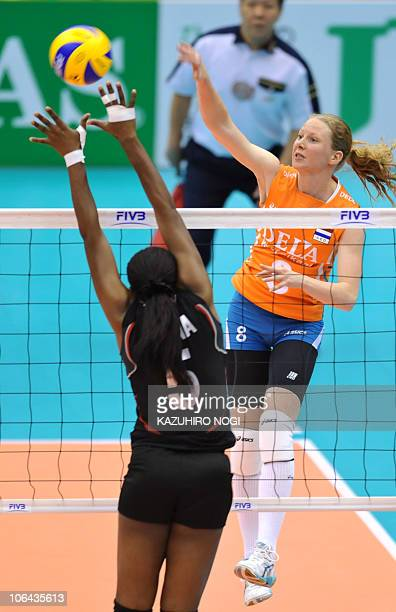 Alice Blom of the Netherlands spikes the ball over Kenya's Diana Khisa during their first round match of the world women's volleyball championship in...