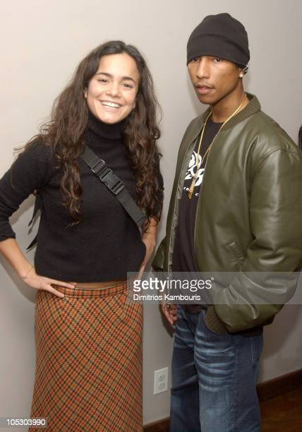 Alice Braga and Pharrell Williams during City of God Special Screening at The SoHo House in New York City New York United States