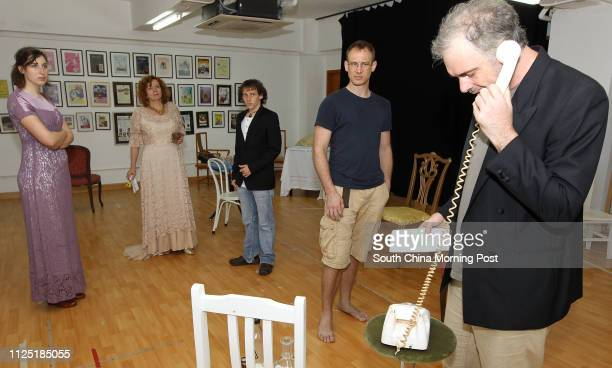Alice Bretton Jacqueline Gourlay Grant Hamish Campbell Nick Deal and Barry O'Rorke rehearsing for the Hong Kong Players' forthcoming production An...