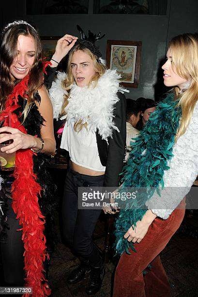 Alice Brinkley Cara Delevingne and Mary Charteris attend the Alice Olivia Black Tie Carnival hosted by designer Stacey Bendet at Paradise by Way of...