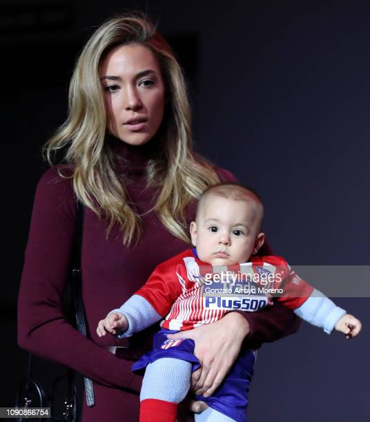 Alice Campello wife of Alvaro Morata looks on with their child during the Club Atletico de Madrid player presentation of Alvaro Morata at Wanda...