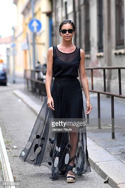 Alice Carli is seen wearing Andrea Incontri dress and Stuart Weitzman shoes during the Milan Men's Fashion Week Spring/Summer 2017 on June 18 2016 in...