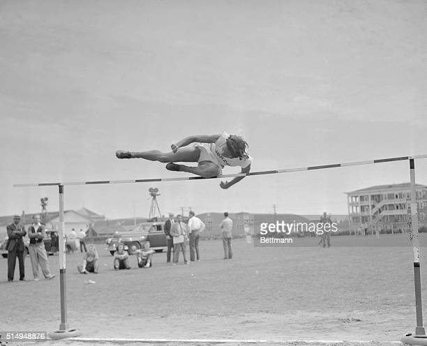 Alice Coachman of Tuskegee Alabama Institute clears the bar in the running high jump at the Women's National AAU track and field championships in...