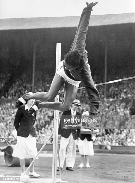 Alice Coachman, woman high jumper from Albany, Ga. Is shown as she cleared the bar with an Olympic record breaking leap of 5 feet, 6 1/8 inches. She...