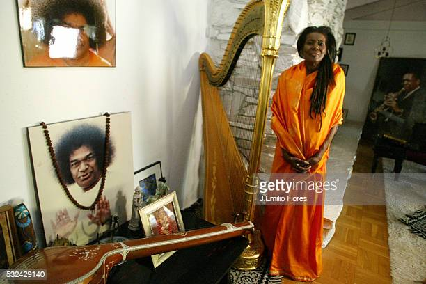Alice Coltrane next to her religious shrine with the portrait of her 'guru' Satya Sai Baba She explored the meditation ways since 1978 and she...