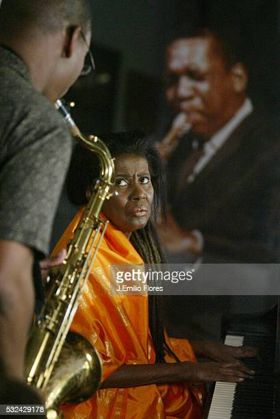 Alice Coltrane plays on the Steinway piano offered by her husband in 1964 and her son Ravi plays the saxophone in front of a photograph of John...