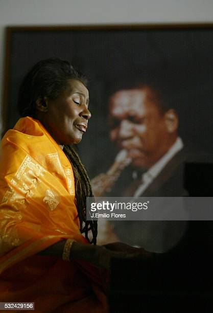 Alice Coltrane wife of John Coltrane plays the piano offered by her husband in 1964 in her California home Alice has been practicing music since the...