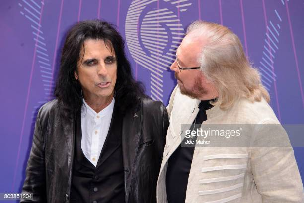 Alice Cooper and Barry Gibb attends Nordoff Robbins O2 Silver Clef awards at The Grosvenor House Hotel on June 30 2017 in London England