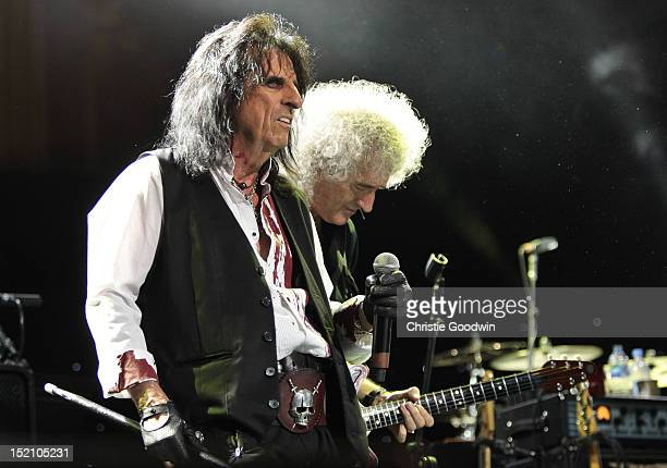 Alice Cooper and Brian May perform on stage during The Sunflower Jam at Royal Albert Hall on September 16, 2012 in London, United Kingdom.