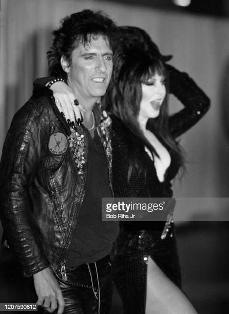 Alice Cooper and Elvira backstage during the 26th Annual Grammy Awards at the Shrine Auditorium, February 28, 1984 in Los Angeles, California.