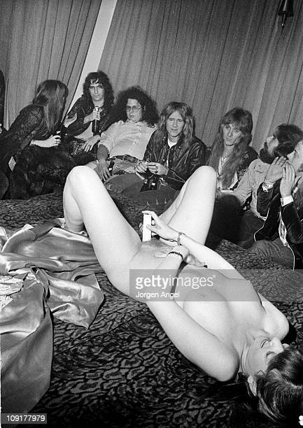 Alice Cooper and his band with Flo Eddie posed at a Sex Show in Copenhagen Denmark on November 22 1972 Mark Volman from Flo Eddie wearing a white...