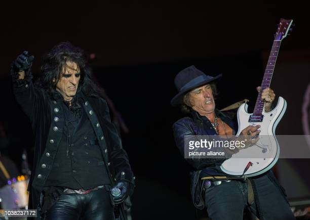 Alice Cooper and Joe Perry from the 'Hollywood Vampires' stand on stage at Hessian Day in Herborn Germany 29 May 2016 The 'Hollywood Vampires'...