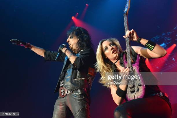 Alice Cooper and Nita Strauss perform live on stage at Wembley Arena on November 16, 2017 in London, England.