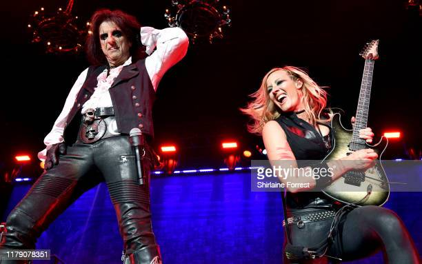 Alice Cooper and Nita Strauss perform on stage at Manchester Arena on October 04, 2019 in Manchester, England.