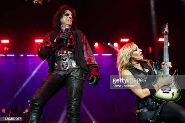 Alice Cooper and Nita Strauss perform on stage at The O2 Arena on October 10, 2019 in London, England.