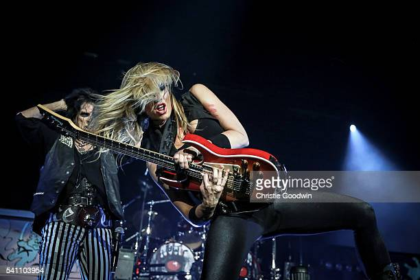 Alice Cooper and Nita Strauss performs on stage at The O2 Arena on June 18 2016 in London England