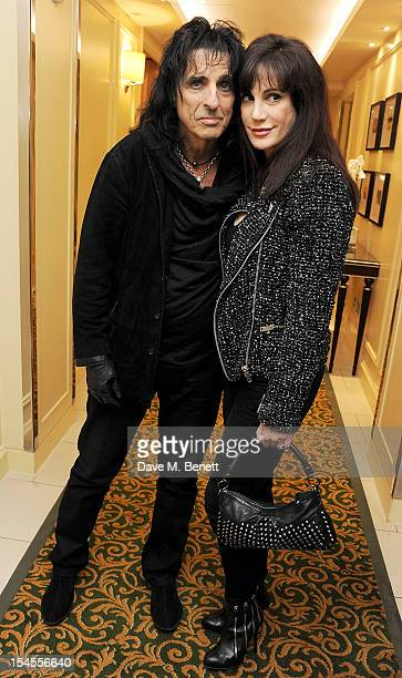Alice Cooper and Sheryl Goddard pose in the press room at The Q Awards 2012 at the Grosvenor House Hotel on October 22 2012 in London England