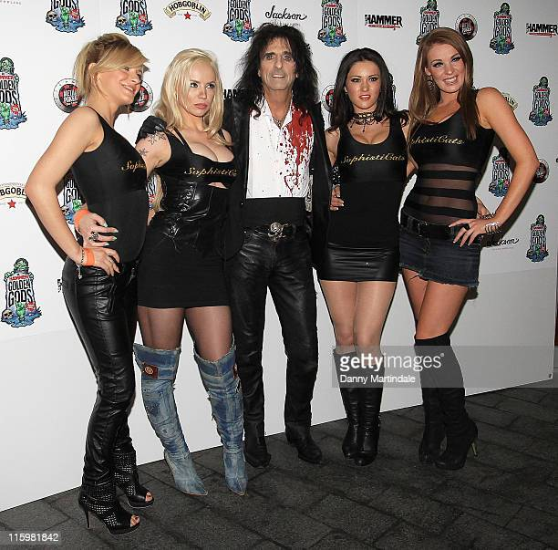 Alice Cooper and show girls attend the Metal Hammer Golden God Awards 2011 at Indigo at O2 Arena on June 13 2011 in London England