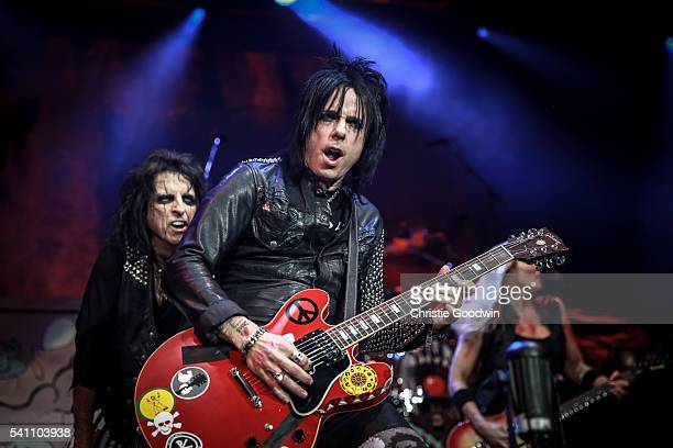 Alice Cooper and Tommy Henriksen perform on stage at The O2 Arena on June 18 2016 in London England