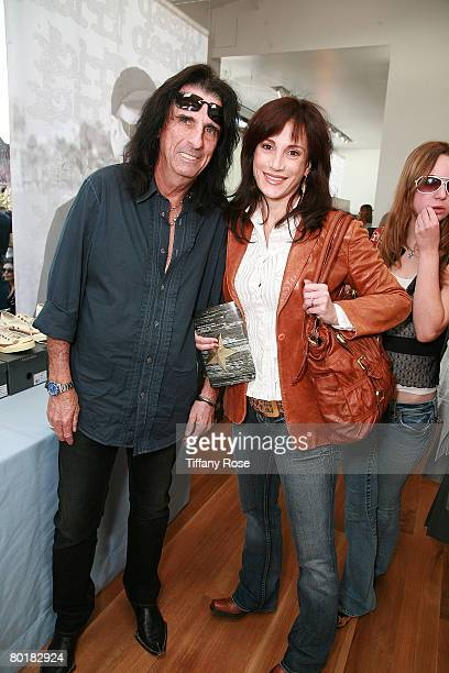 Alice Cooper and wife Sheryl pose with a shoe at The John Varvatos 6th Annual Stuart House Benefit at the John Varvados Boutique March 9 2008 in West...